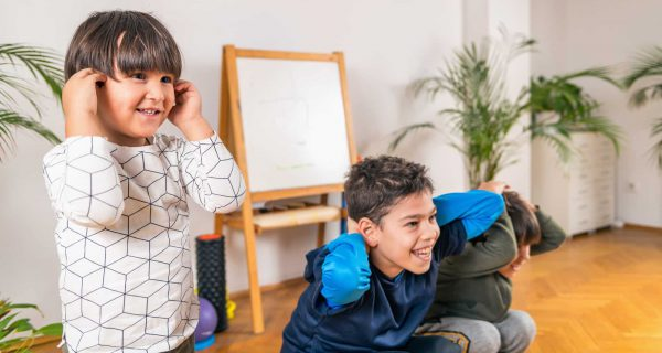 Children Exercising Indoors